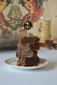 Boozy Brownies with salted caramel RUM sauce from Tattoed Martha.